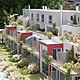 Mit der Sanierung denkmalgeschützter Gebäude im Golfpark Fürth, schafft P&P Wohnbau Franken in grüner Umgebung Platz für modernes Wohnen.