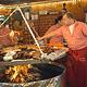 Kulinarische Spezialitäten und hausgemachte Leckerbissen versüßen, manchmal im wahrsten Sinne des Wortes, den Besuch auf der Michaelis-Kirchweih.
